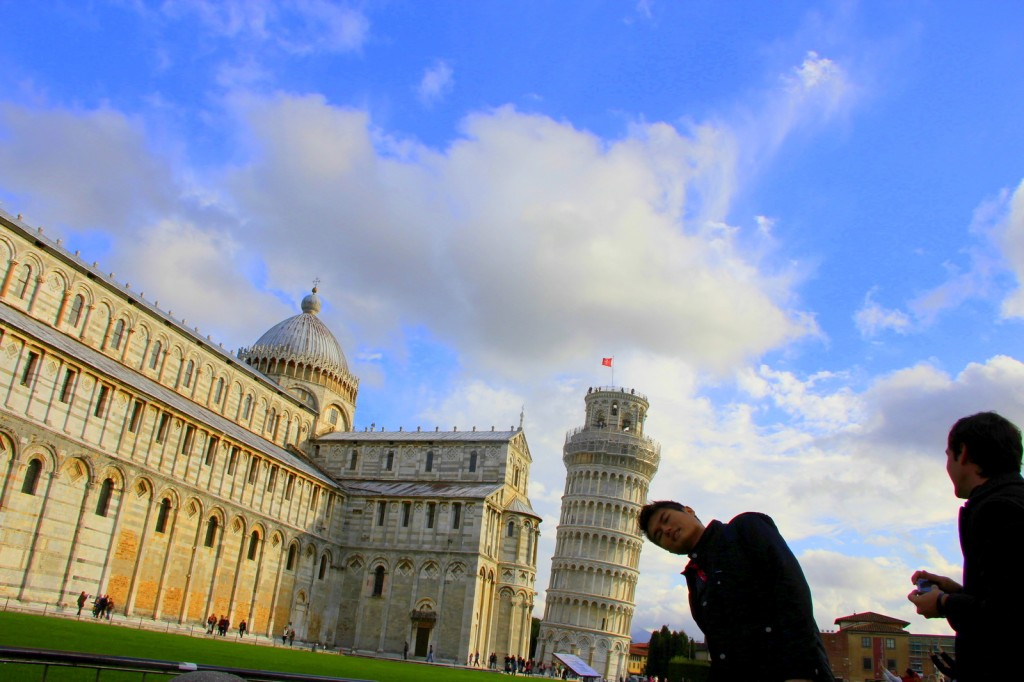 When everyone uses their hand, I choose to use my head to support Pisa tower, Pisa, Italy