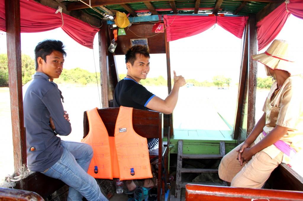 Sailing a boat at Floating Village, Cambodia