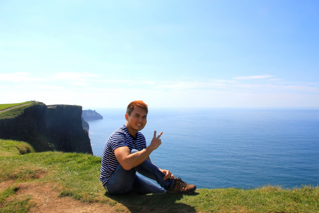 Sitting at the edge of The Cliffs of Moher