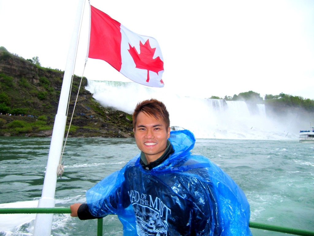 With American Falls and Canadian Flag