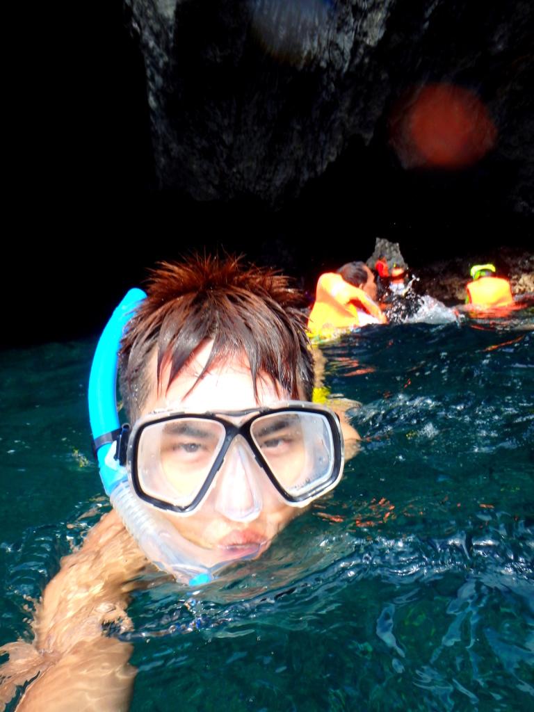 Swim through the narrow crevice to enter or exit the Secret Beach