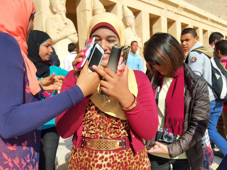 The locals were delighted and suddenly there were many smiles and of course, many different hand-phones! :-)