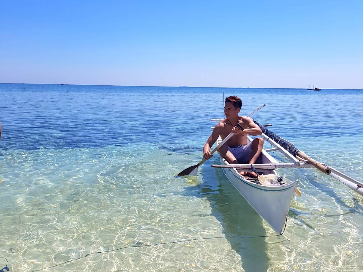 Shirtless boatman Kodingareng Islands