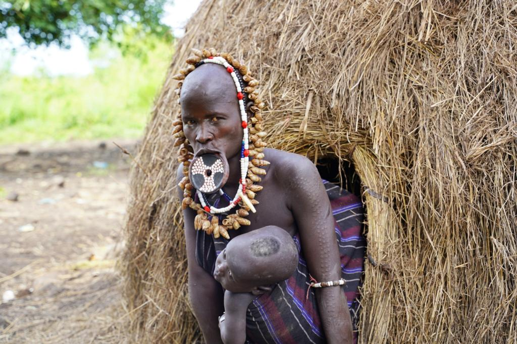 Mursi Tribe woman with a baby