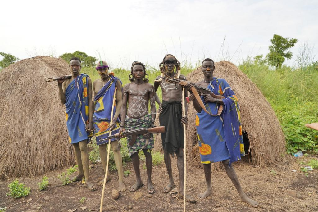 Mursi Tribe Men With Rifle