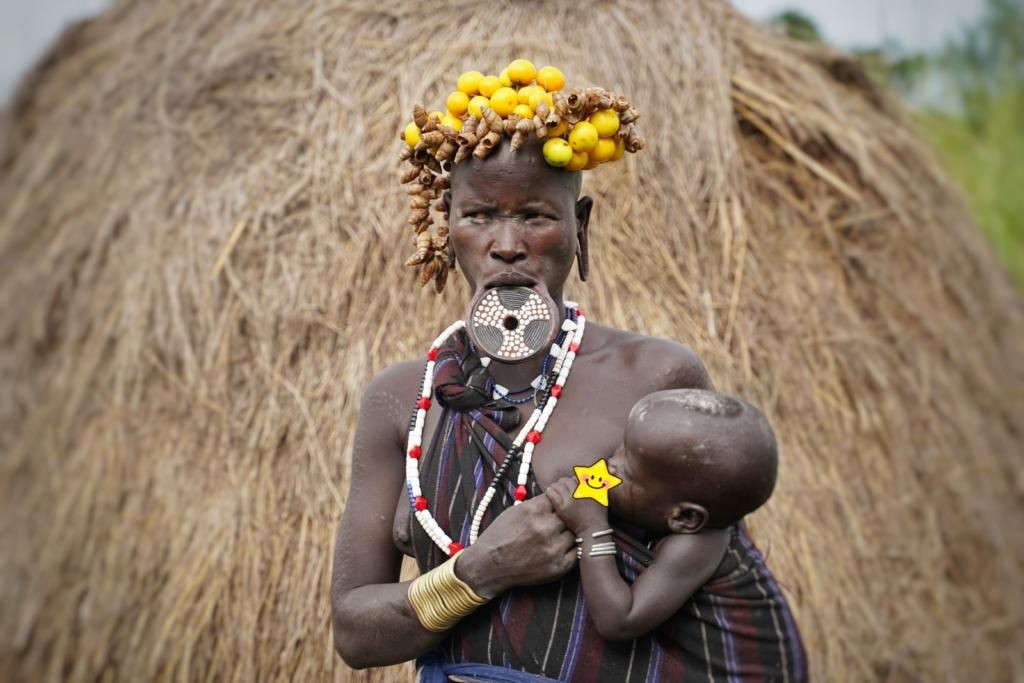 Mursi Tribe lady with Lip plate feeding her baby