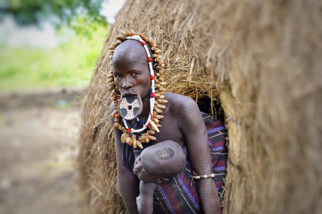 Mursi Tribe lady with baby