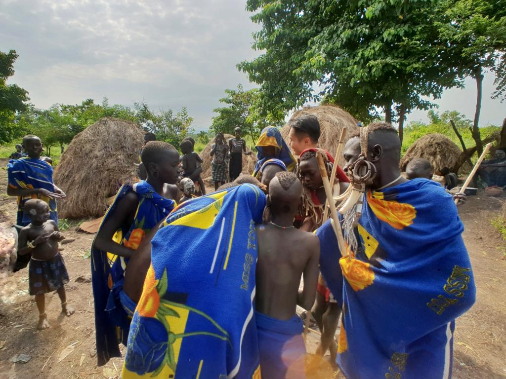 The aggressive Mursi Tribe snatching away my gifts for the children
